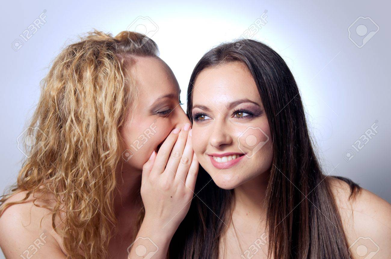 Young woman sharing secret to her friend Stock Photo - 9745732