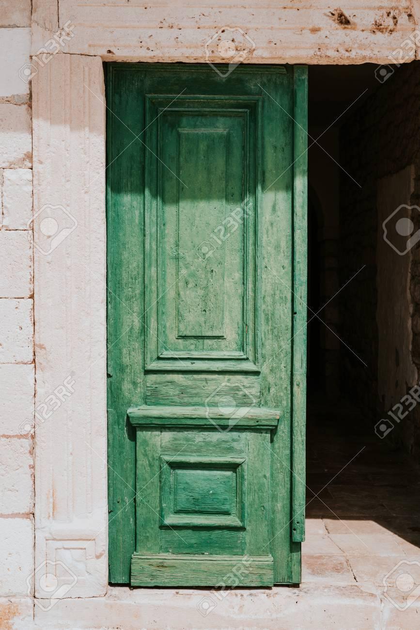 Old green doors in City of Hvar - 79698756