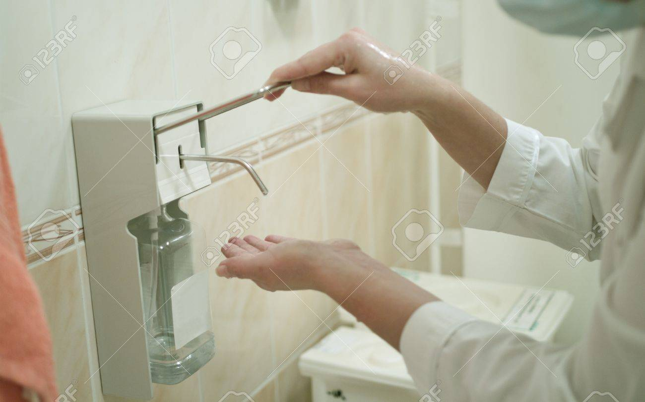 A health occupation worker washing her hands before any intervention. Shallow DOF Stock Photo - 11573808
