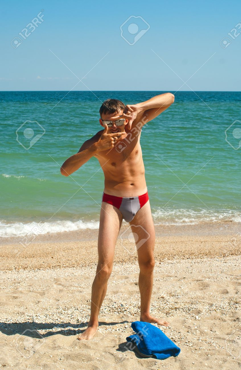 azov boy The young guy on beach of sea of Azov. Berdyansk spit, Ukraine Stock Photo