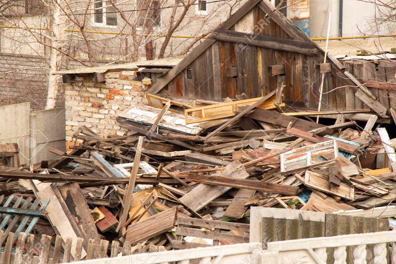 old ruined house covered with boards in Ukraine - 148102511
