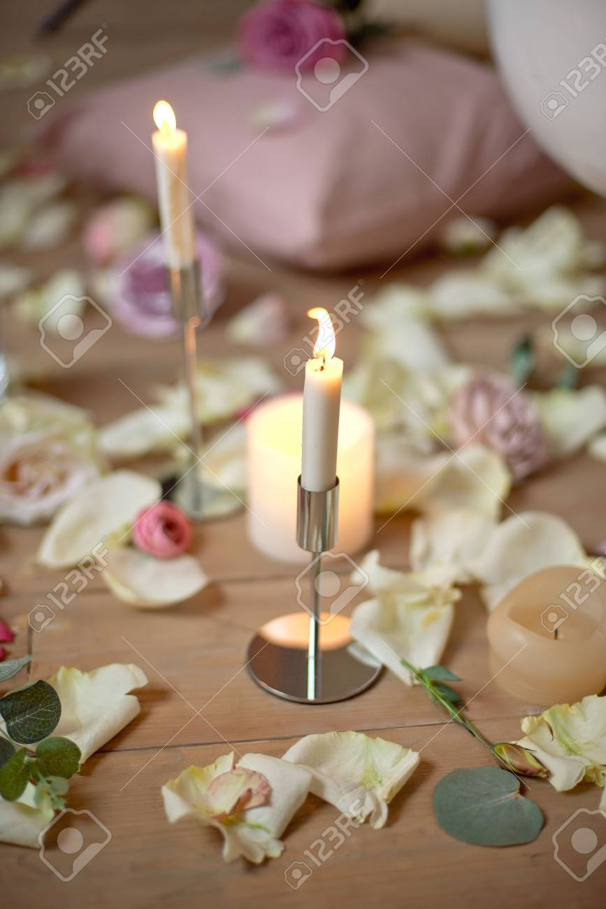 Spa, health, beauty and wellness concept with rose petals scattered