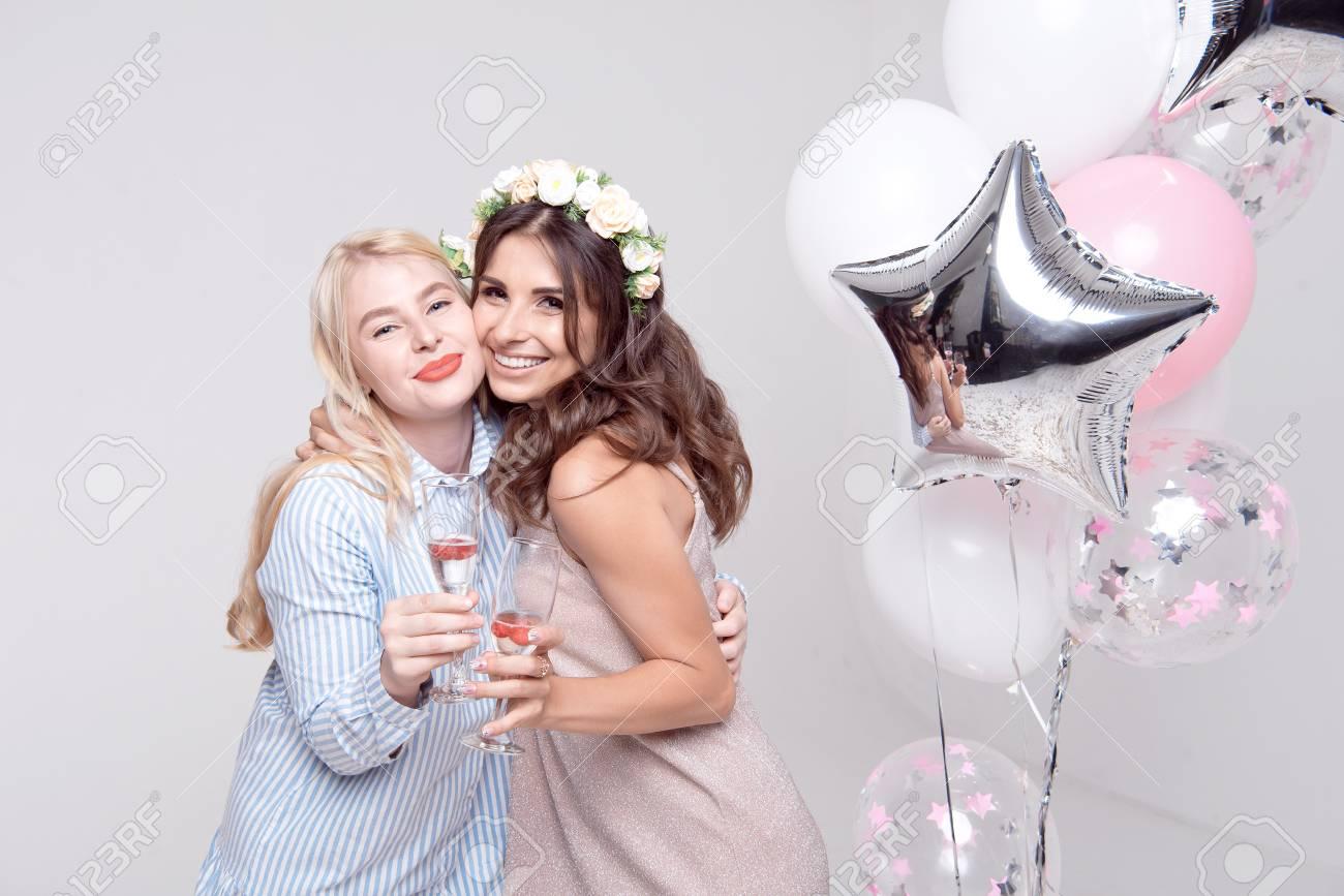 ae277f991e Foto de archivo - Smiling girlfriends having fun celebrating bachelorette  party