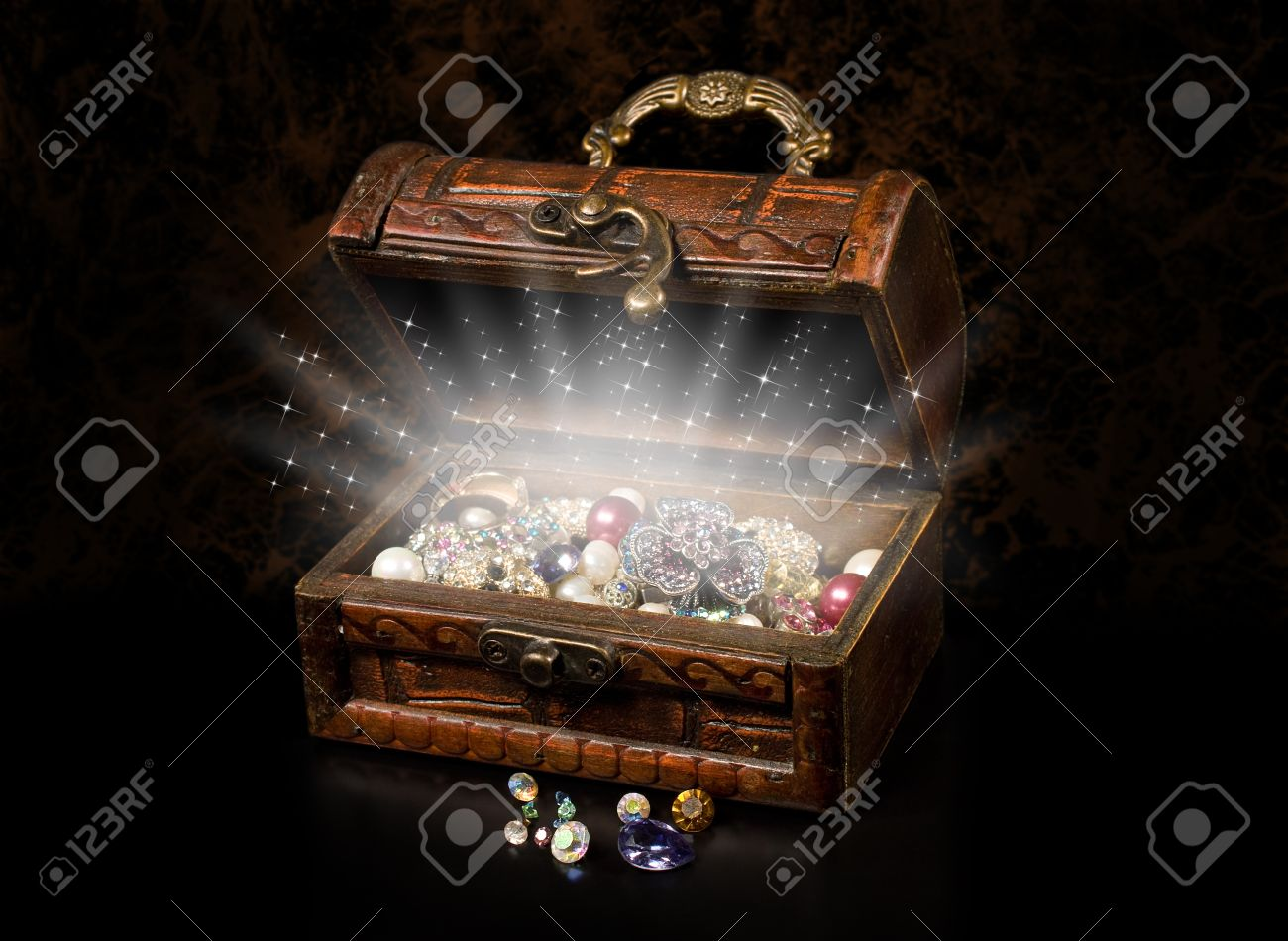antique chest of pirate treasure on a dark background stock photo
