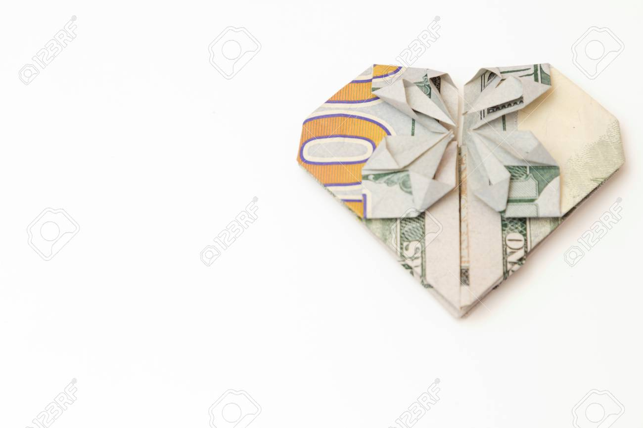 Dollar bill folded heart on a white background stock photo dollar bill folded heart on a white background stock photo 74412719 jeuxipadfo Images