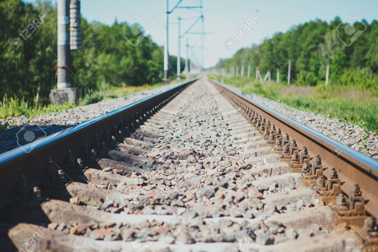 Railway track to the up country. Railway rail close-up, background, wallpaper