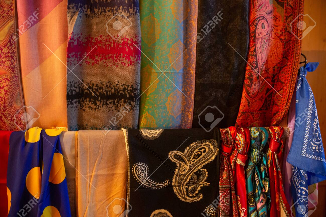 Traditional oriental cloth scarf sold in a store in old town Sheki, Azerbaijan. - 140178954