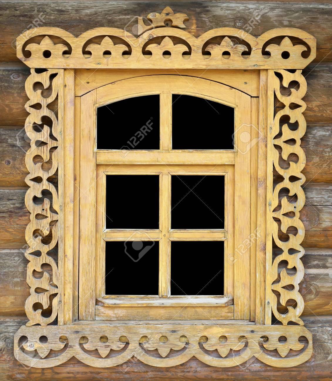 Handmade Carved Wooden Window Frame In A Log Village Shed