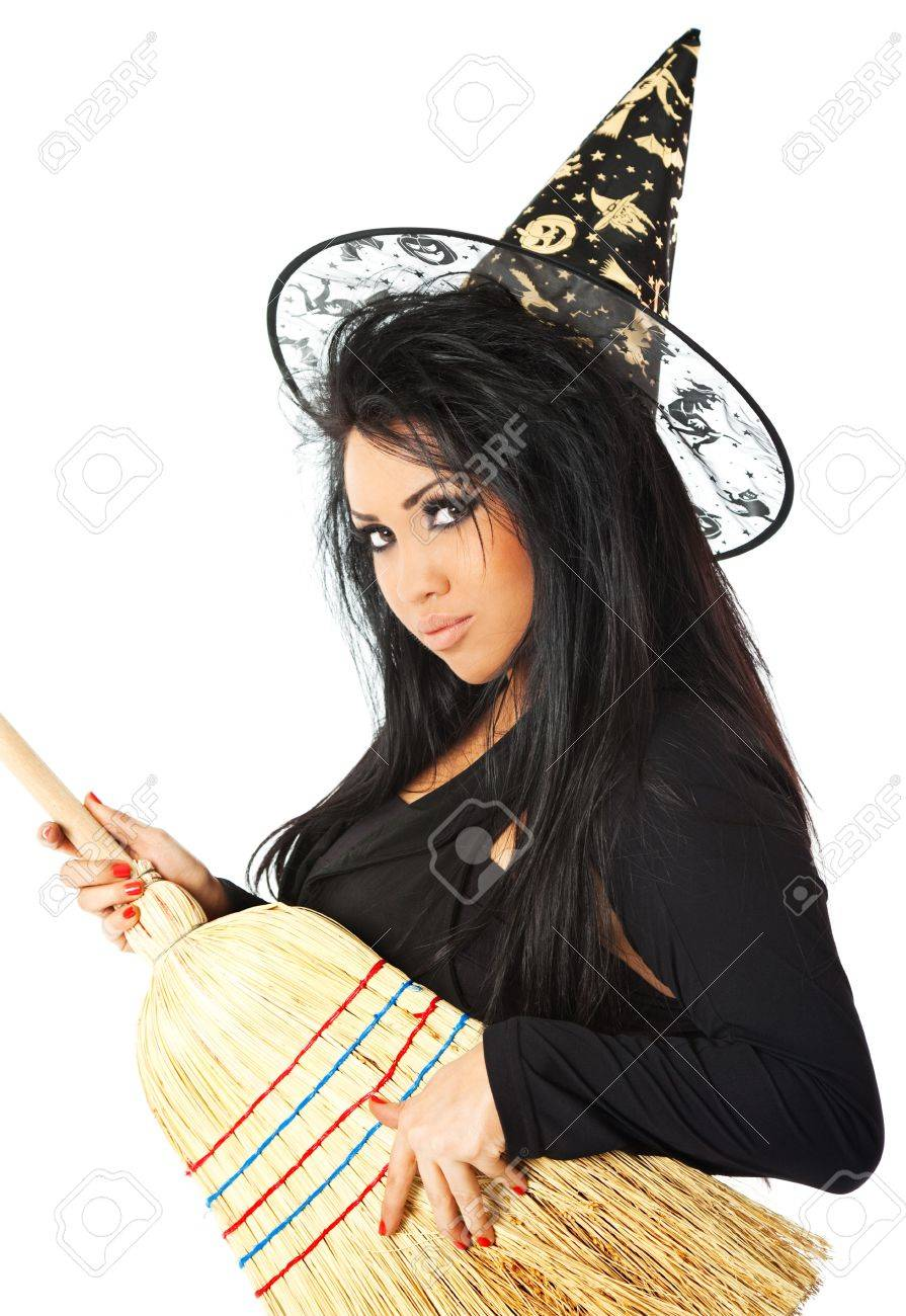 hispanic female in witch costume holding a broom stock photo