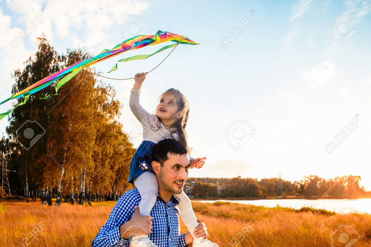 happy father with a little daughter, having fun in nature, in the rays of the sunset. - 169432303