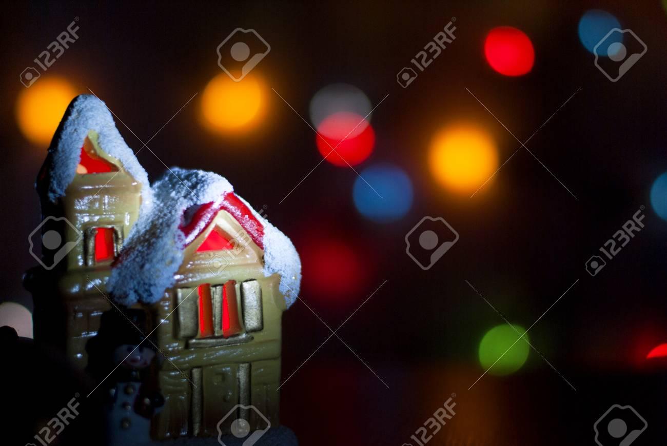 Colorful Christmas Lights On House.Christmas Light House On A Background Of Colorful Bokeh