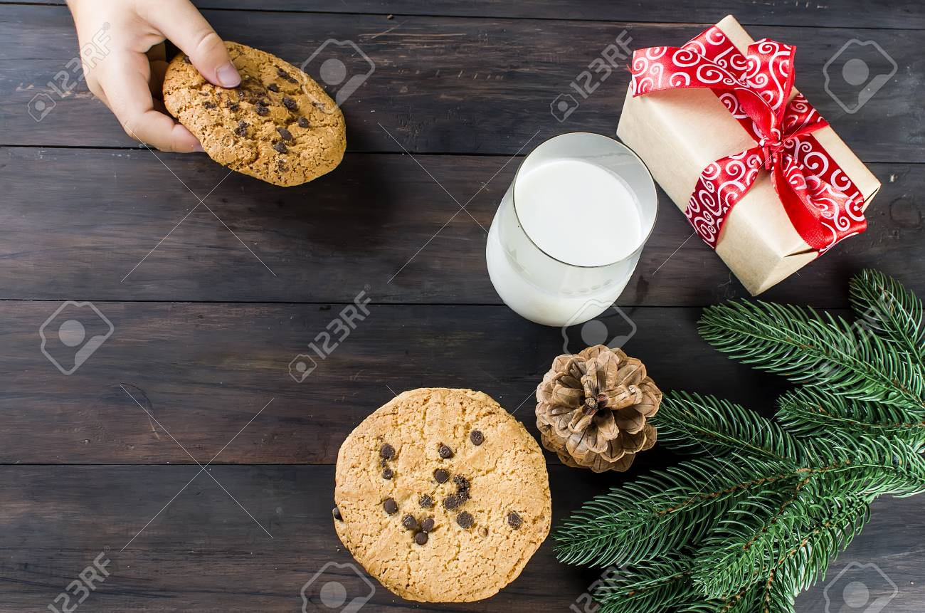 Glass Of Milk And Cookies With Chocolate Drops For Santa Child