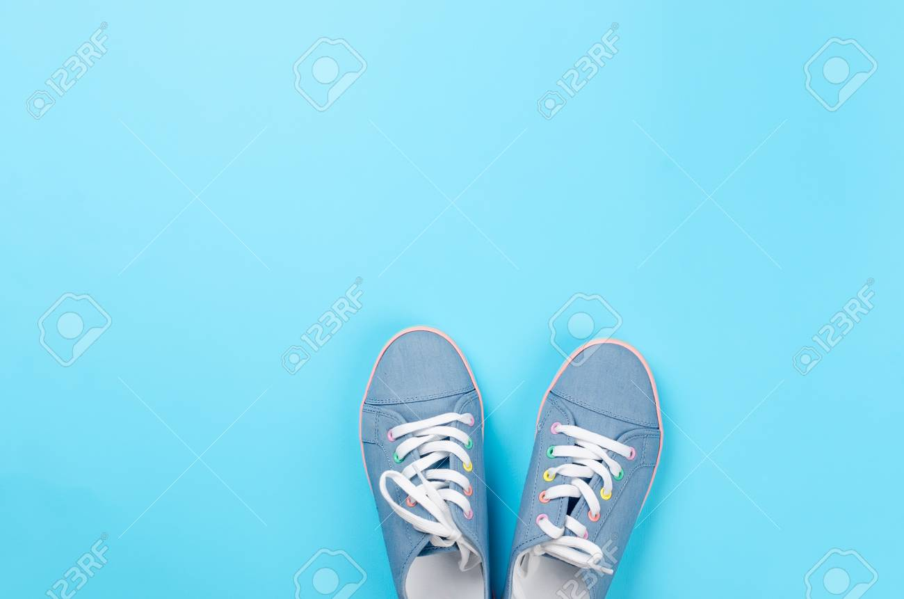 A Pair Of Blue Canvas Sneakers On Light