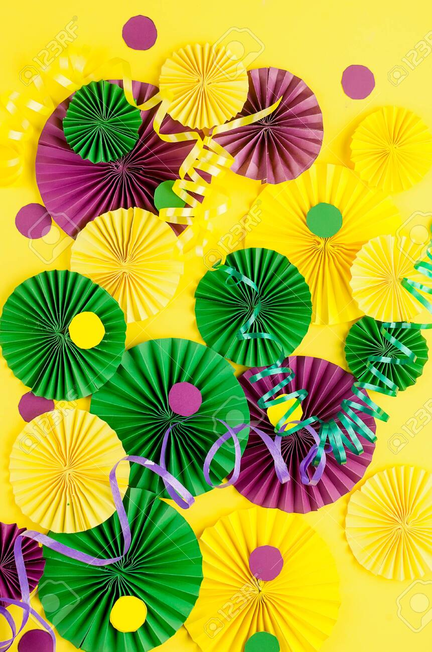 Colorful paper confetti, carnivale mask and colored serpentine on a yellow background with copy space, greeting card and party invitation template design for carnival or birthday, Mardi Gras, - 140759018