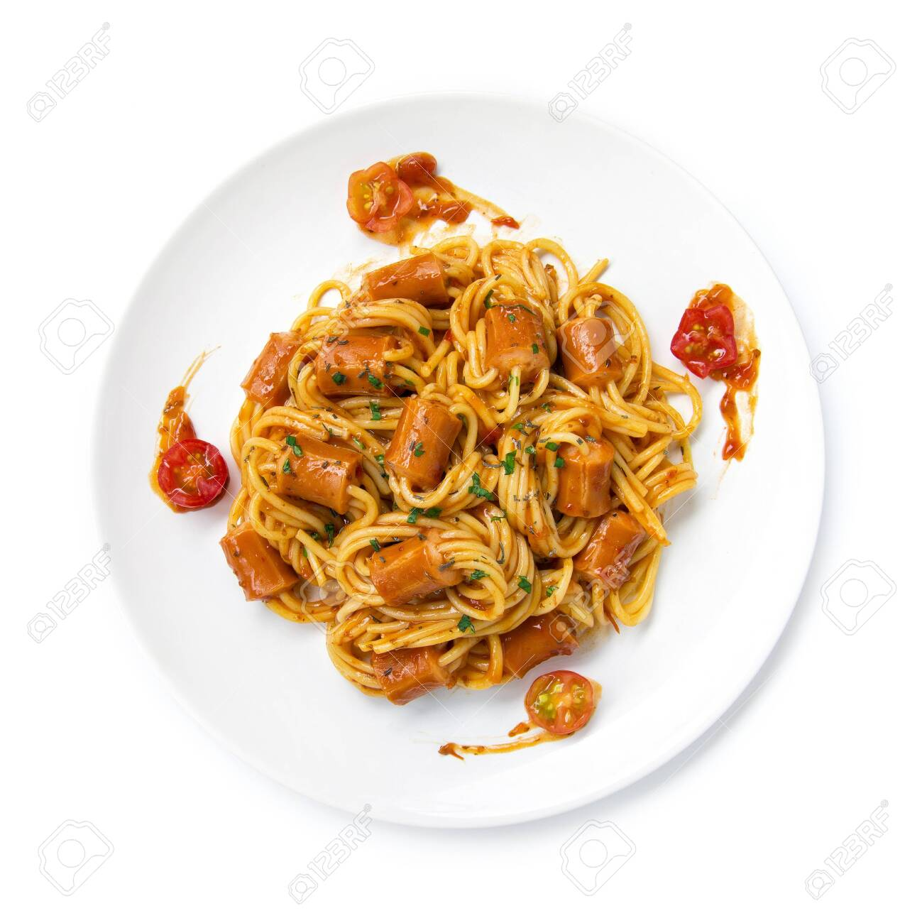 Spaghetti Bolognese with saucesage in tomato sauce topped chopped leaf basil sprinkle fusion food Italian traditional style decorate with carved tomato cherry top view - 147647267