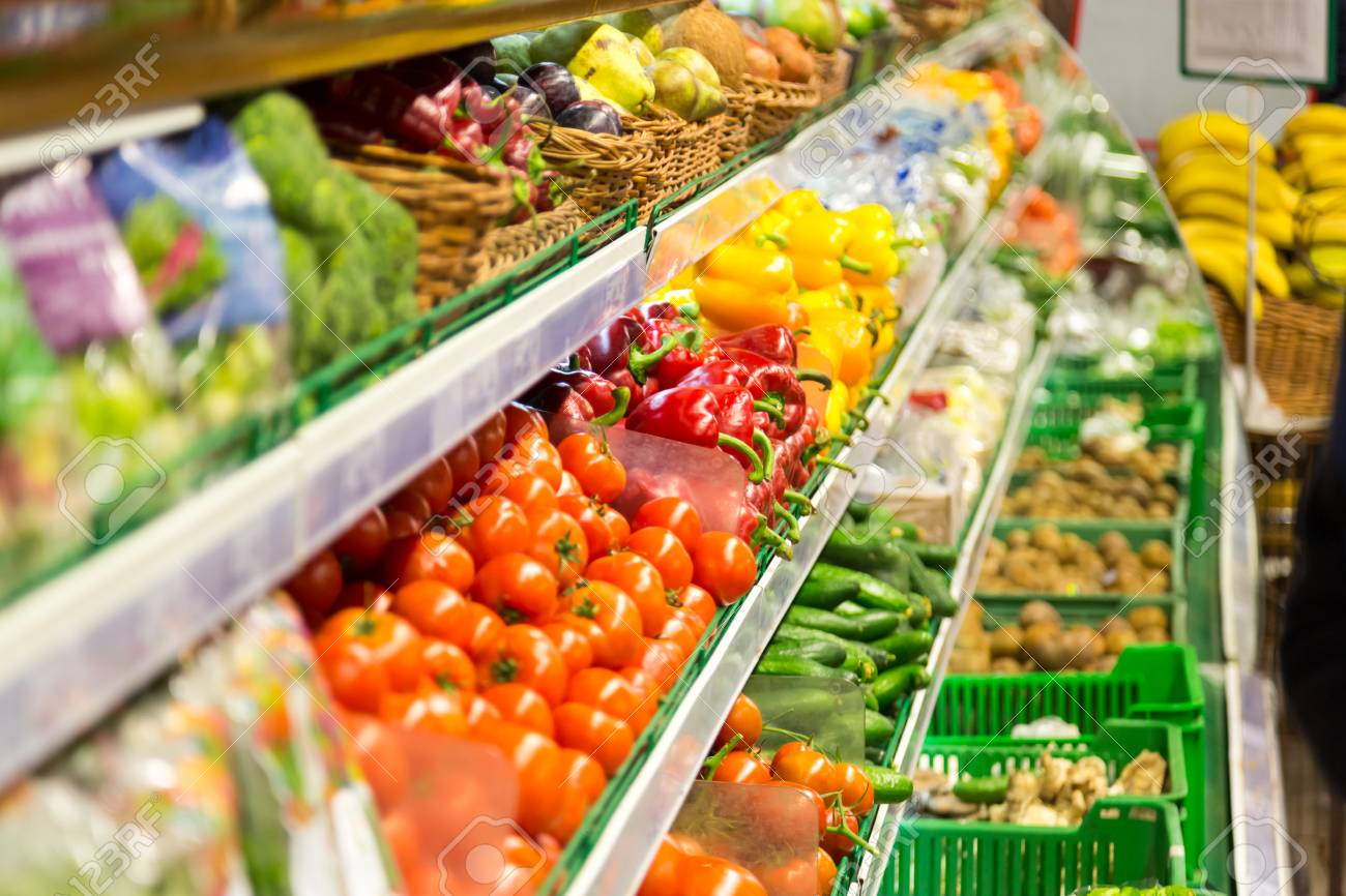 fruits and vegetables are on the shelves of the supermarket. Healthy Eating - 77234278