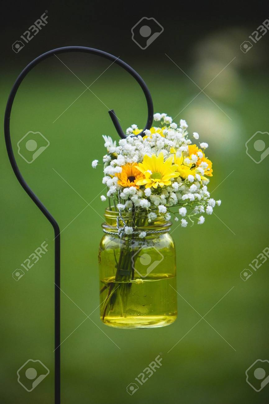 Wedding Bouquet Flowers Yellow And White Daisies Along Processional