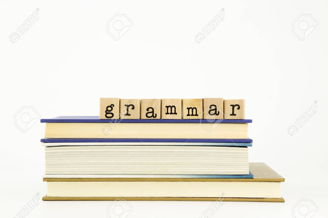 grammar word on wood stamps stack on books, language and education concept - 29500525