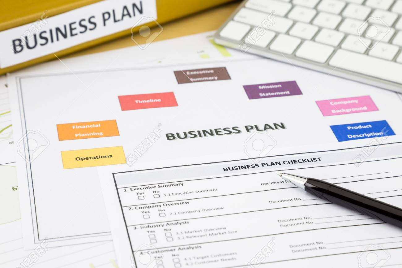 business plan checklist and paperwork place on office table stock