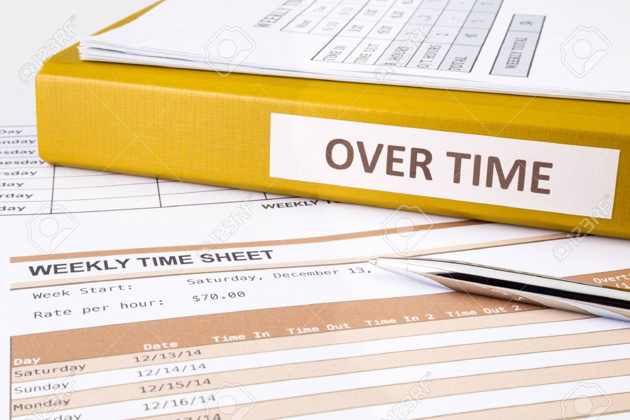 Overtime words on document binder place on blank weekly time sheets - 34899174