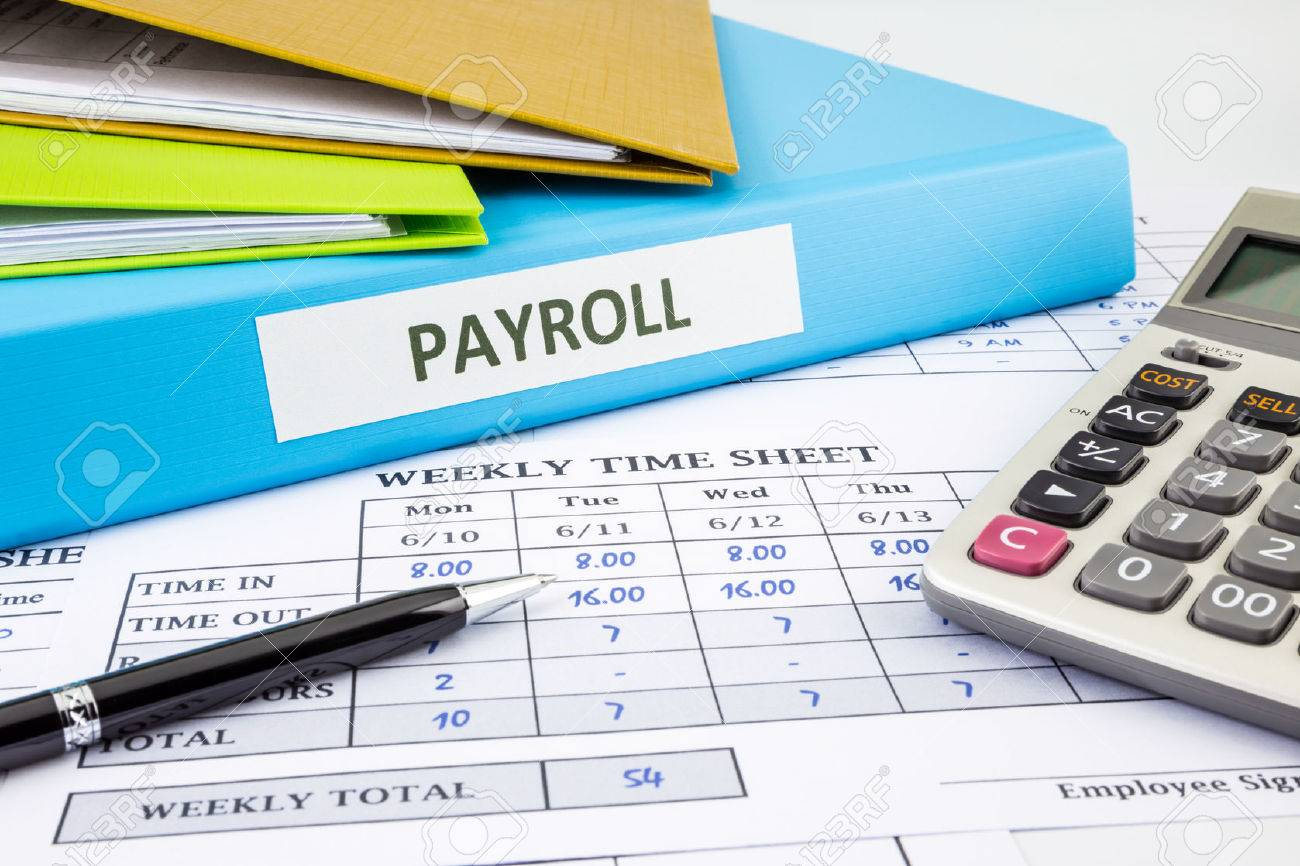 payroll word on blue binder place on weekly time sheet and payroll