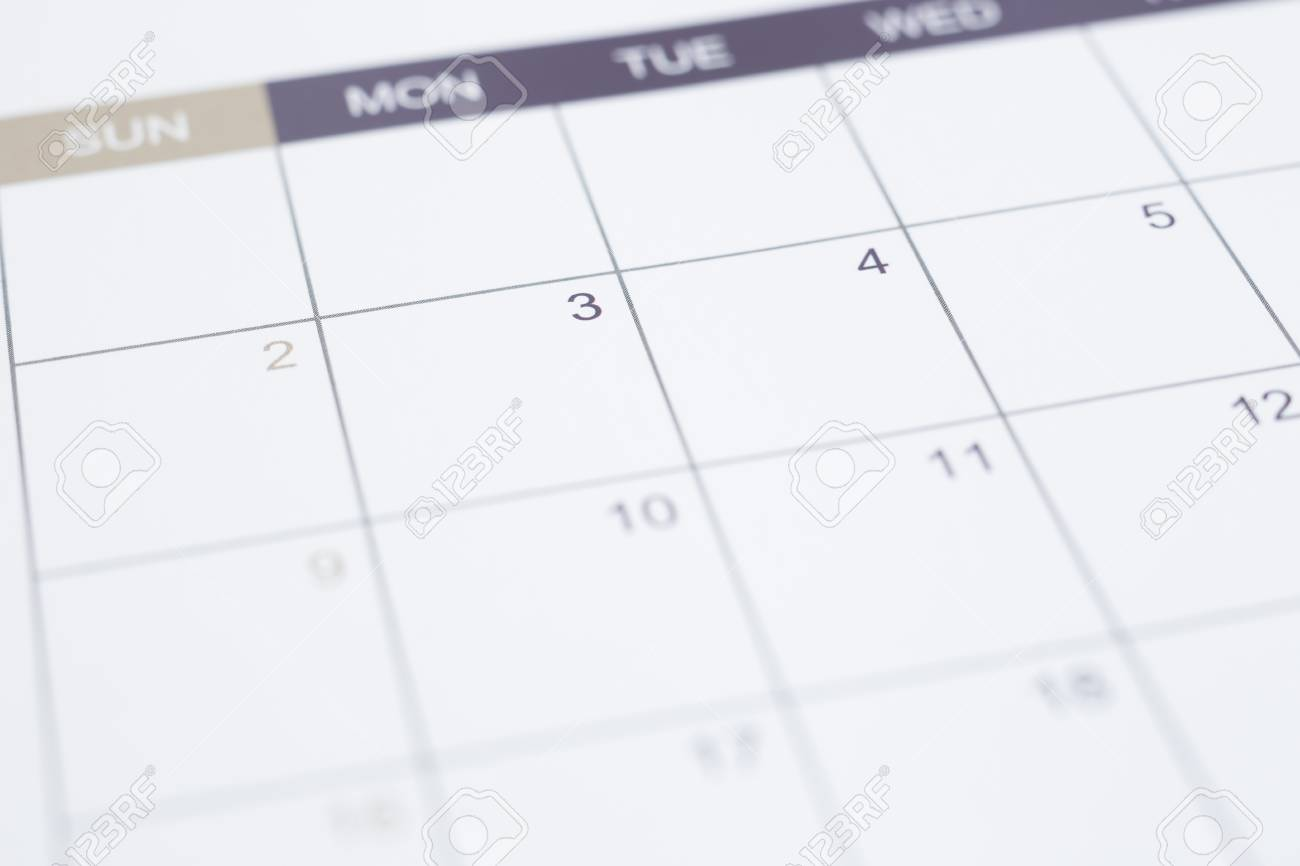 Closeup of dates on blank calendar page  Simple timetable planning
