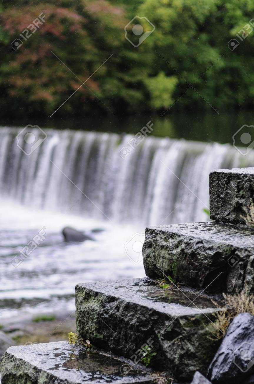 wet stone stairs with waterfall background stock photo picture and