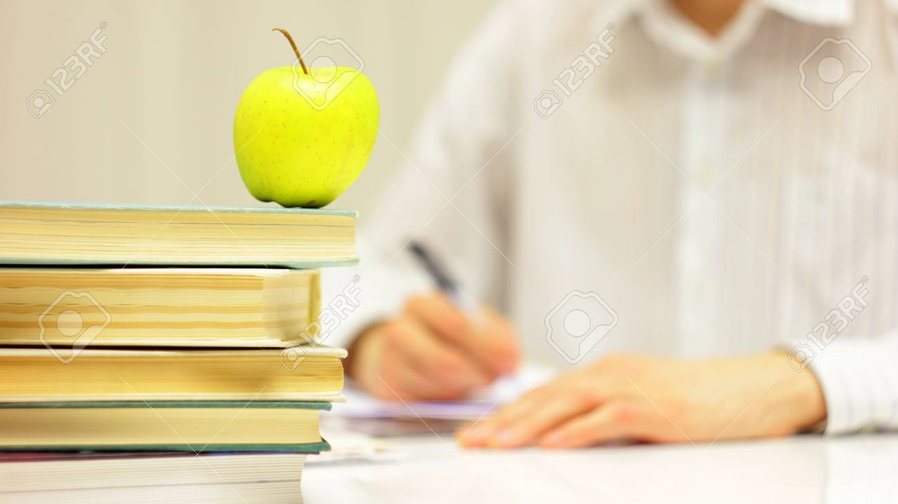 Doing Homework With Books And Apple As Symbol Of Education Stock