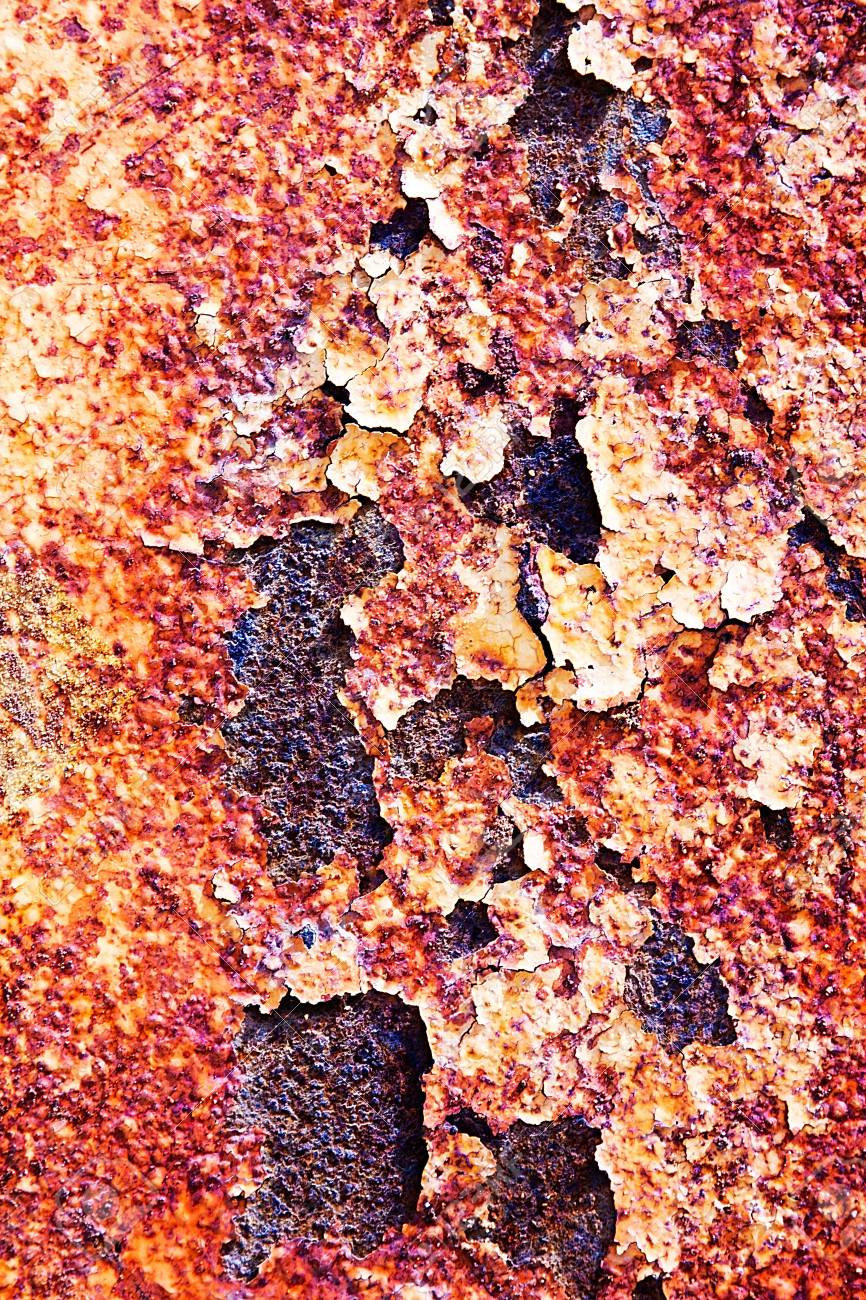 Cracked paint on an old metal surface. Grunge rusty metal texture Stock Photo - 19104750