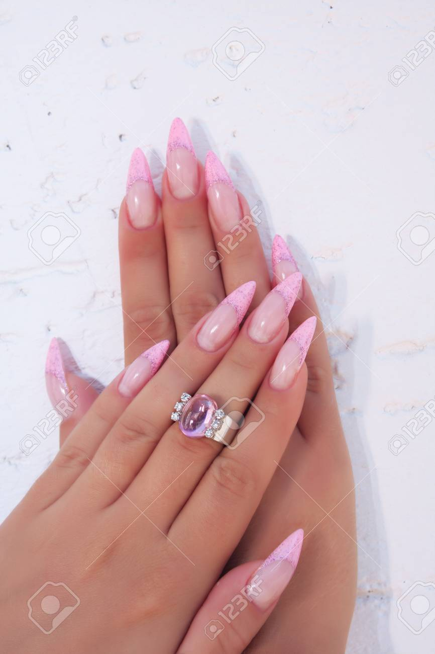 Long French Nails With White Manicure On A Woman S Hand With Stock Photo Picture And Royalty Free Image Image 115693787