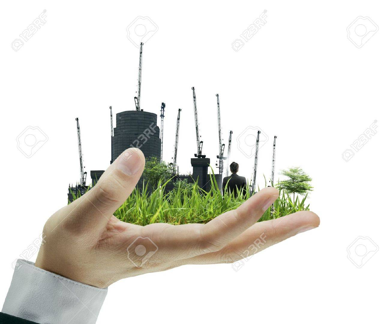 person holding a business, building on hand Stock Photo - 10046540