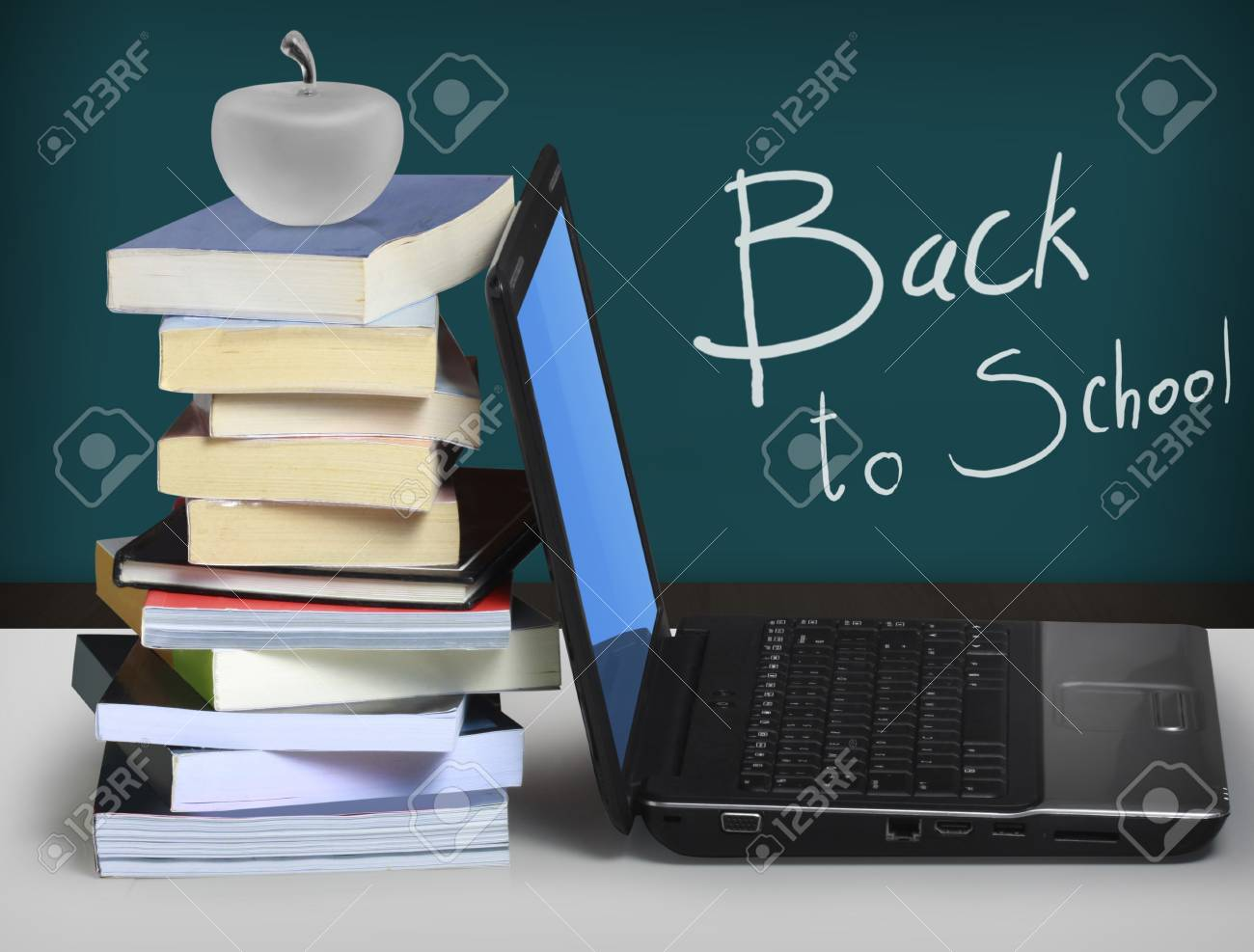 Laptop with a book Stock Photo - 10645784