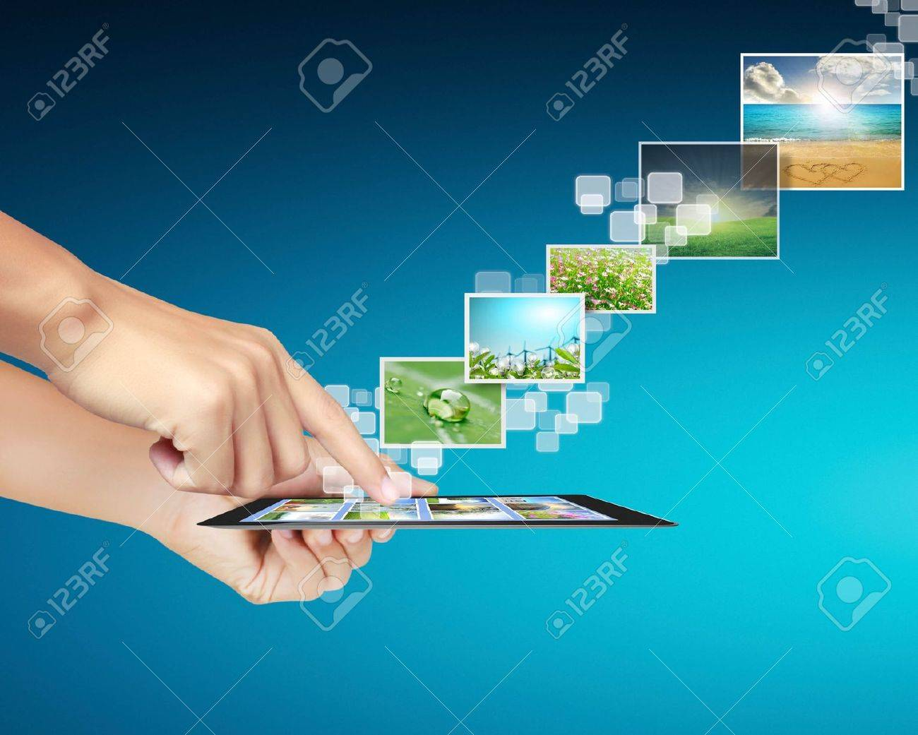touch tablet concept images streaming from in hand Stock Photo - 14344893