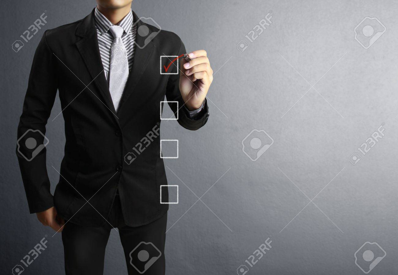 Business men hand drawing in a whiteboard Stock Photo - 14763356