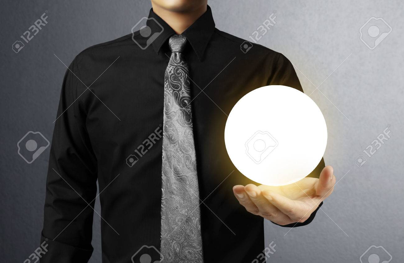 Businessman hand holding the Crystal Ball Stock Photo - 24083417