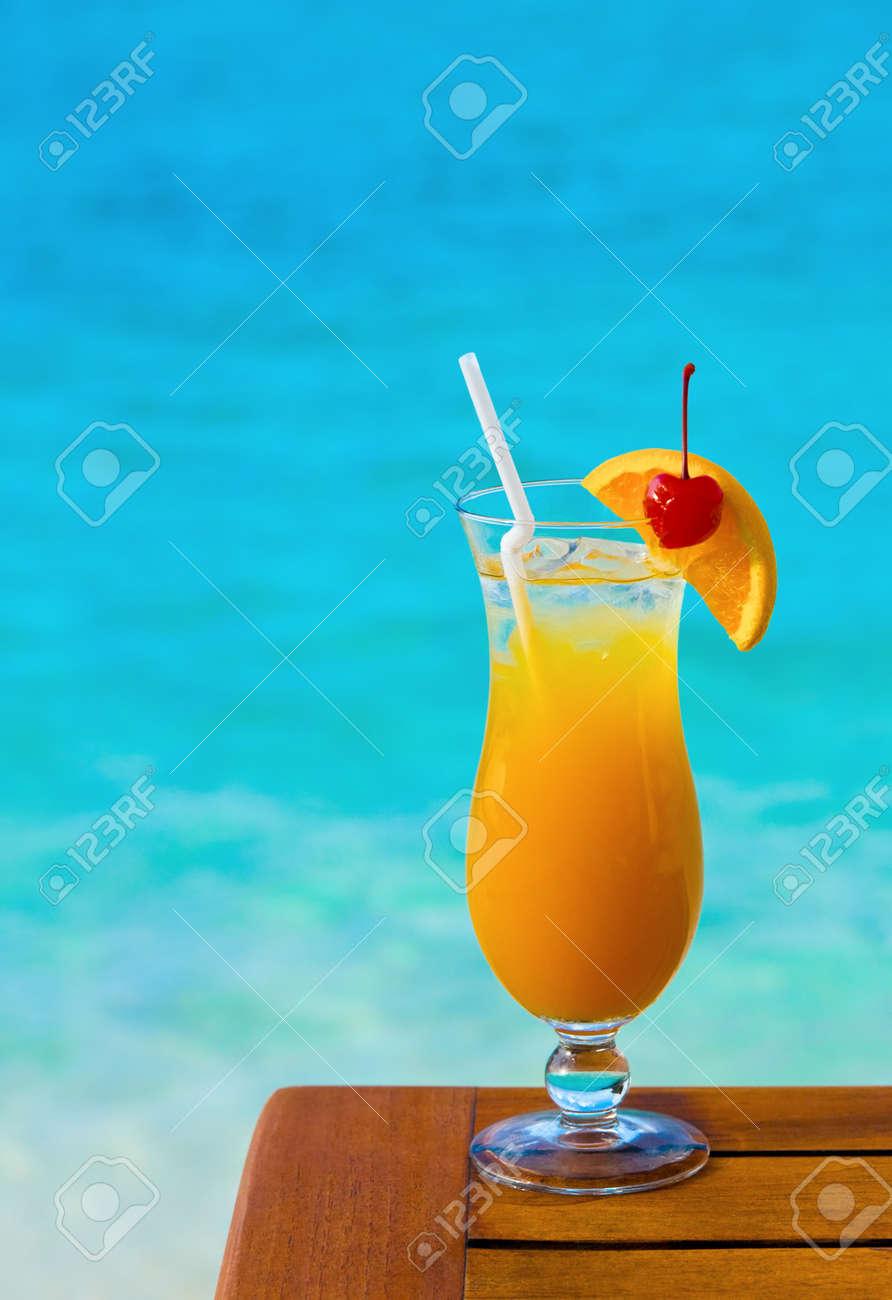 Orange cocktail on table, sea background Stock Photo - 4430373
