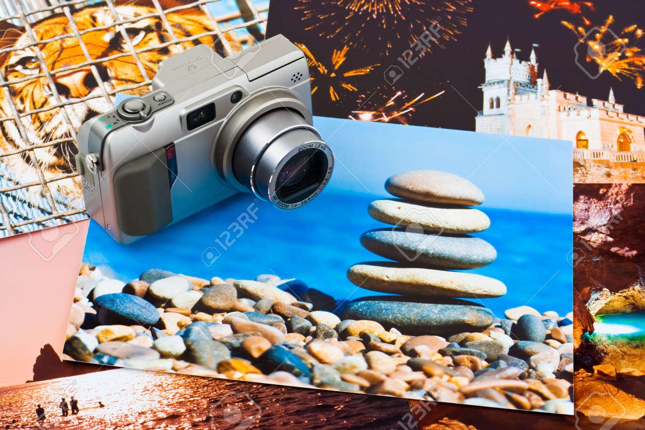 Camera and photo printouts (my photos), travel background Stock Photo - 4696948