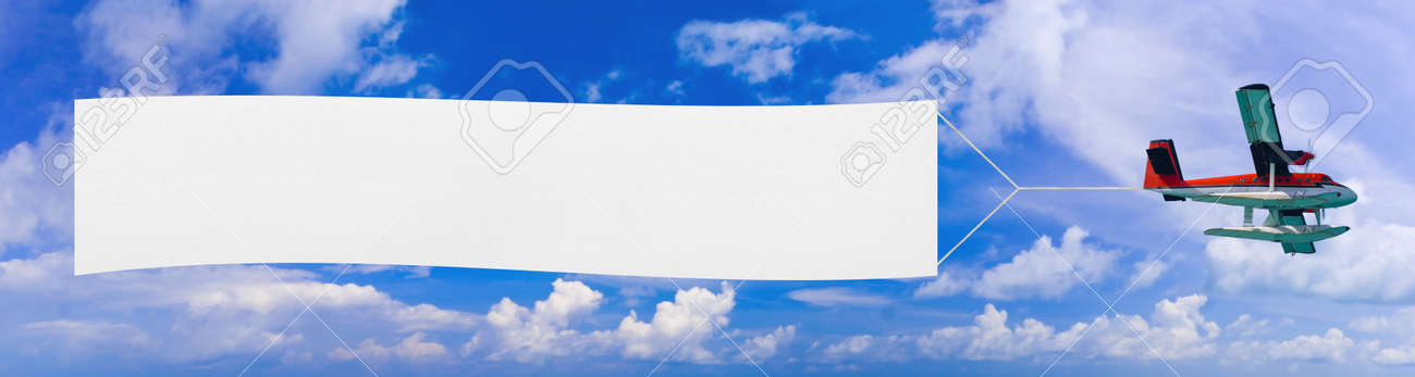 Flying airplane and banner, sky on background Stock Photo - 5088479