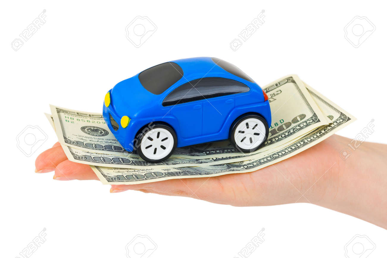 Hand with money and toy car isolated on white background Stock Photo - 5684221