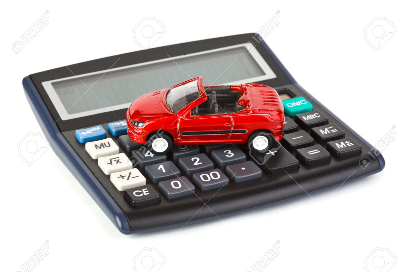 Calculator and toy car isolated on white background Stock Photo - 6968696