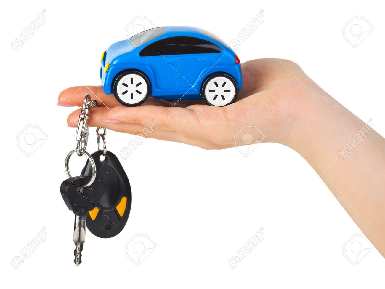 Hand with keys and car isolated on white background Stock Photo - 7698576