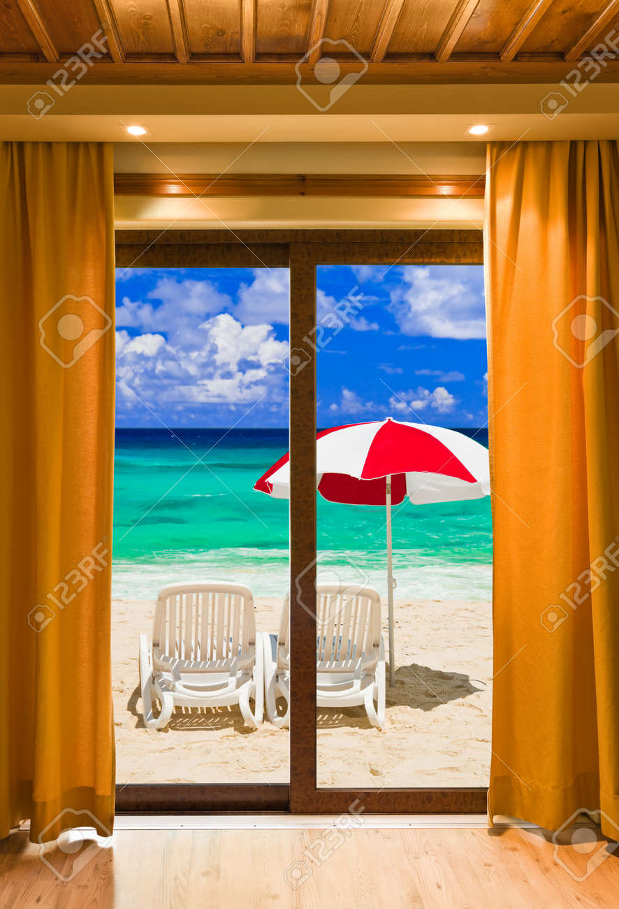 Open window beach - Hotel Room And Beach Landscape Vacation Concept Background Stock Photo 8989933