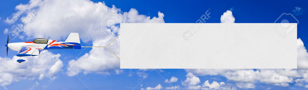 Flying airplane and banner - sky on background Stock Photo - 9139245