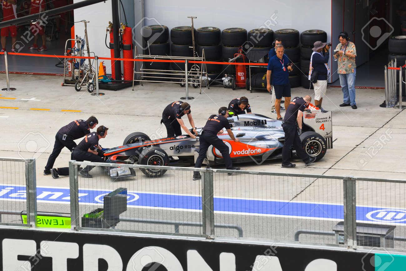 SEPANG, MALAYSIA - APRIL 8: Jenson Button (team Vodafone McLaren Mercedes) on the pit at first practice on Formula 1 GP, April 8 2011, Sepang, Malaysia Stock Photo - 9411049