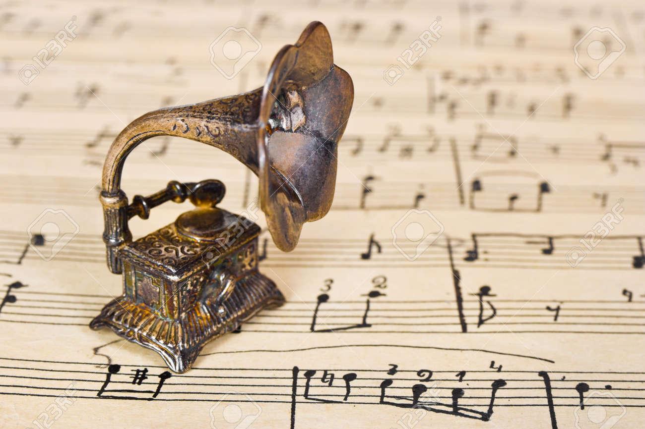 Gramophone on old sheet music - retro art background Stock Photo - 9681613