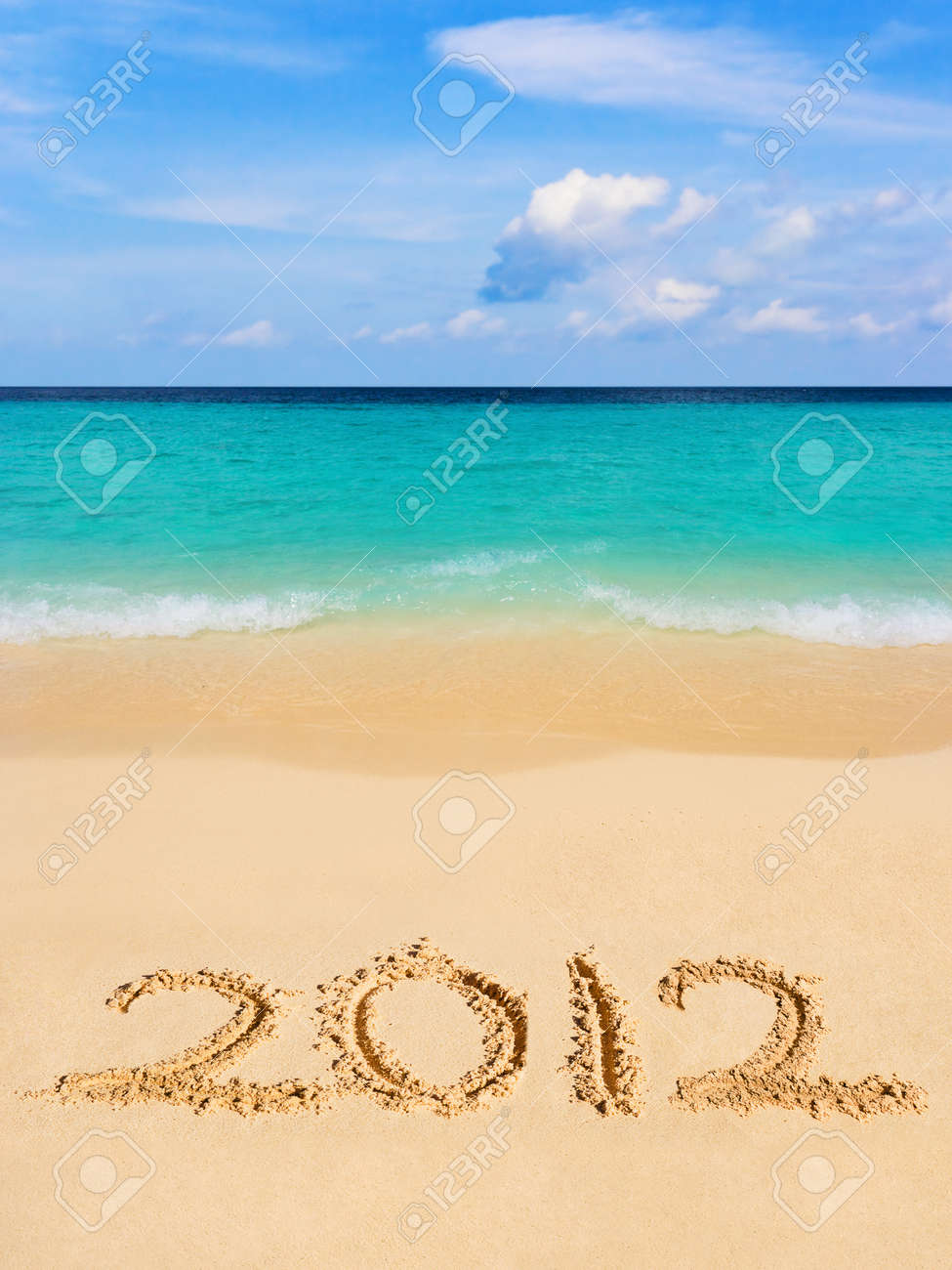 Numbers 2012 on beach - concept holiday background Stock Photo - 11438141
