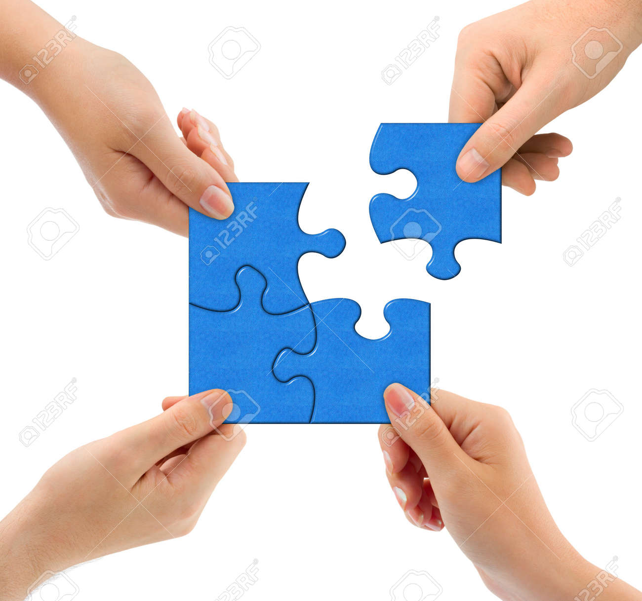 Hands and puzzle isolated on white background Stock Photo - 12003528