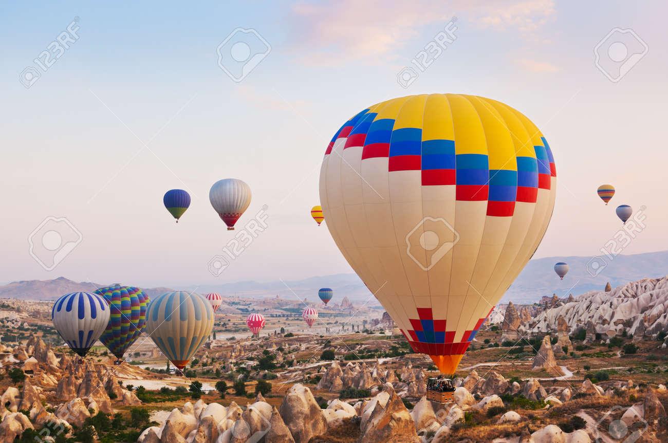 Hot air balloon flying over rock landscape at Cappadocia Turkey Stock Photo - 17661969