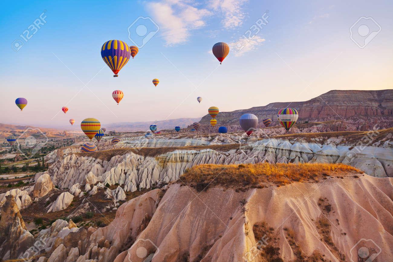 Hot air balloon flying over rock landscape at Cappadocia Turkey - 40592256
