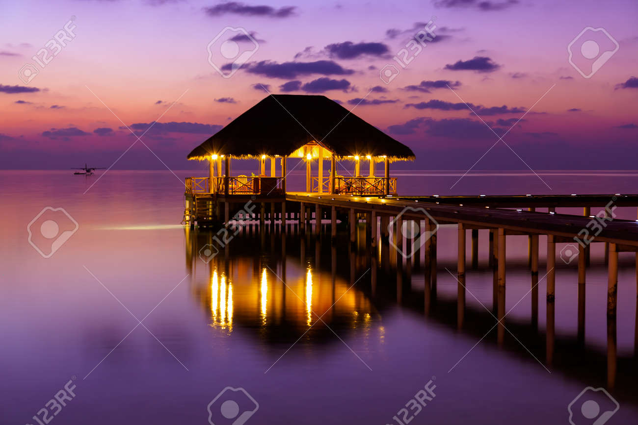 Water cafe at sunset - Maldives vacation background - 43524150
